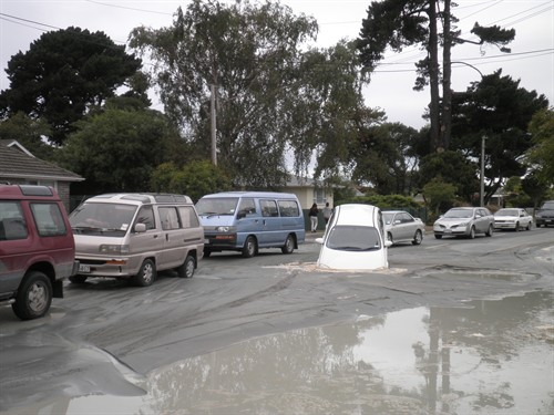 Cars in liquefaction on Breezes Road
