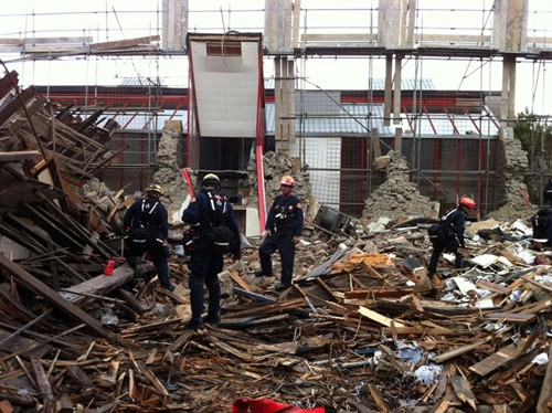 Members of the USAID Disaster Assistance Response Team (DART) searching through the rubble of a collapsed building in the Christchurch central city.